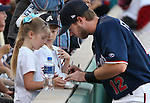 Reno Aces' Mike Freeman signs autographs before a game in Reno, Nev., on Saturday, Sept. 6, 2014. The Reno Aces defeated the Las Vegas 51s, 7-3, to win the Pacific Conference Championship Series. <br /> Photo by Cathleen Allison