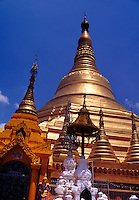 Architectural detail of the ornate, guilded spires of the Shwedagon Pagoda. Yangon, Myanmar, Burma