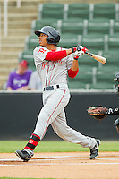 Mookie Betts (7) of the Greenville Drive follows through on his swing against the Kannapolis Intimidators at CMC-Northeast Stadium on June 30, 2013 in Kannapolis, North Carolina.  The Drive defeated the Intimidators 3-0.   (Brian Westerholt/Four Seam Images)