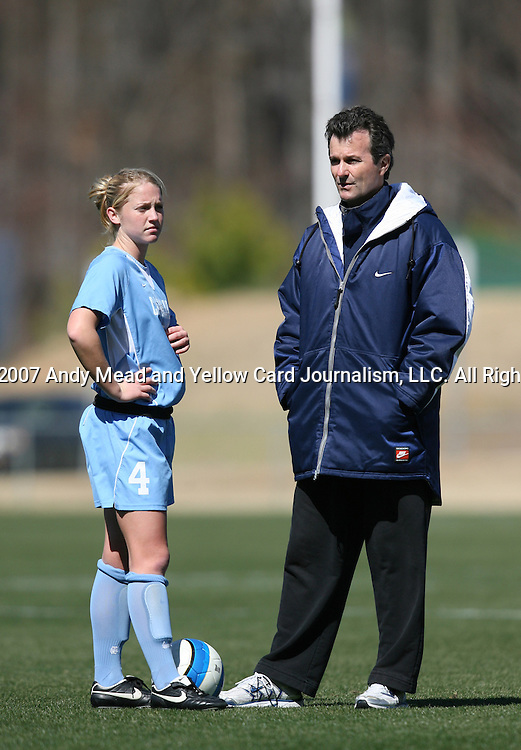North Carolina's Melissa Hayes (4) and head coach Anson Dorrance on Saturday, March 3rd, 2007 on Field 1 at SAS Soccer Park in Cary, North Carolina. The Duke University Blue Devils played the University of North Carolina Tarheels in an NCAA Division I Women's Soccer spring game.