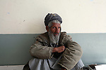 An old man sits in the hallway of a school in the town of Delaram in Farah province, western Afghanistan. March 15, 2009 DREW BROWN/STARS AND STRIPES