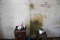 A rice cooker and other modest possession of Wang Xinglong are seen in his room at Yangjia Hospital in Wuji County, China's Zhejiang Province October 19, 2015. Wang Xinglong, who was diagnosed with pneumoconiosis when he was a young miner spends ten days every year at the hospital checking his health condition. Yangjia Hospital, once considered top medical institution treating pneumoconiosis with latest imported equipment is not able to keep the high standards since becoming private in 2001 and is now offering only basic care for remaining patients, all of them former miners suffering from diseases causes by dust in lungs.     REUTERS/Damir Sagolj