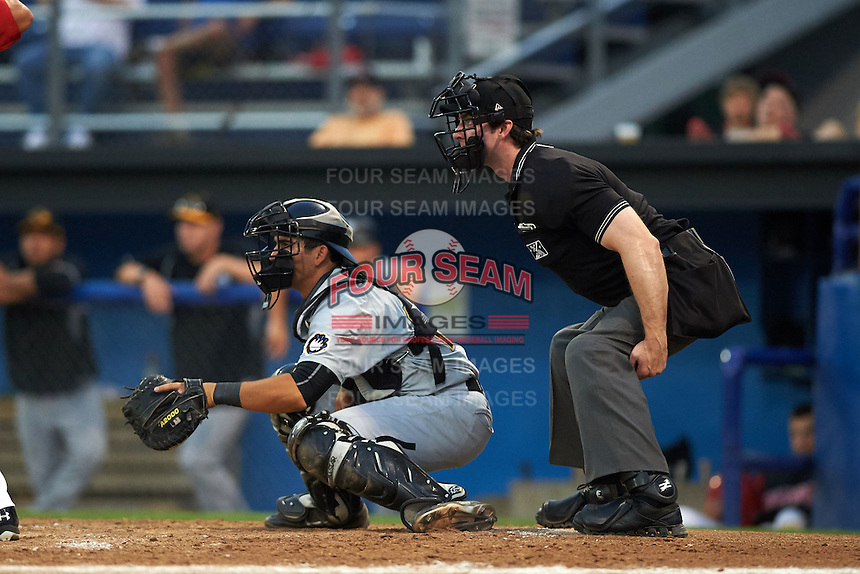 West Virginia Black Bears catcher Christian Kelley (16) and umpire  Matt Scott during a game against the Batavia Muckdogs on August 31, 2015 at Dwyer Stadium in Batavia, New York.  Batavia defeated West Virginia 5-4.  (Mike Janes/Four Seam Images)