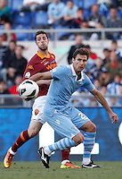 Calcio, finale di Coppa Italia: Roma vs Lazio. Roma, stadio Olimpico, 26 maggio 2013..AS Roma forward Mattia Destro, left, is challenged by Lazio midfielder Lorik Cana, of Kosovo, during the Italian Cup football final match between AS Roma and Lazio at Rome's Olympic stadium, 26 May 2013..UPDATE IMAGES PRESS/Isabella Bonotto....