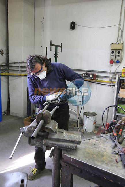 Paolo works on steel forks on the shop floor of the Tommasini factory based in Grosseto, Tuscany, Italy 6th March 2017.<br /> Picture: Eoin Clarke | Newsfile<br /> <br /> <br /> All photos usage must carry mandatory copyright credit (© Newsfile | Eoin Clarke)