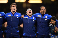 Alexandre Flanquart, Guilhem Guirado and Thierry Dusautoir of France sing their national anthem. Rugby World Cup Pool D match between France and Ireland on October 11, 2015 at the Millennium Stadium in Cardiff, Wales. Photo by: Patrick Khachfe / Onside Images