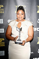 US actress Mo'nique poses with her award in the press room at the 25th Independent Spirit Awards held at the Nokia Theater in Los Angeles on March 5, 2010. The Independent Spirit Awards is a celebration honoring films made by filmmakers who embody independence and originality..Photo by Nina Prommer/Milestone Photo