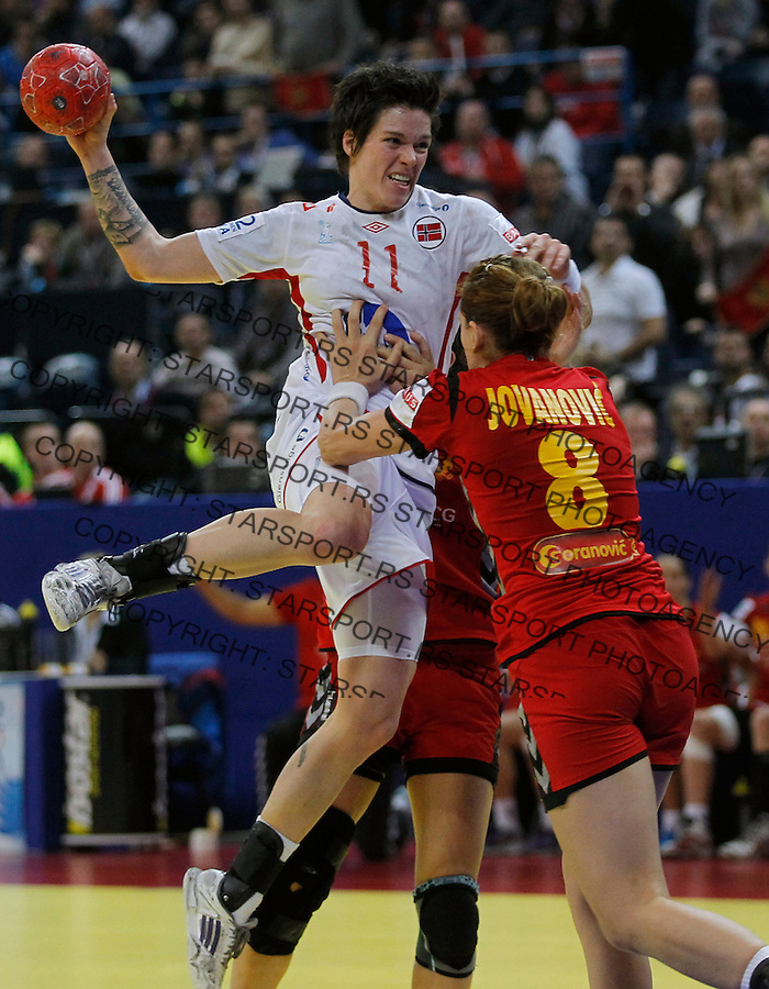 BELGRADE, SERBIA - DECEMBER 16: Anja Edin (L) of Norway is challenged by Marija Jovanovic of Montenegro (R) during the Women's European Handball Championship 2012 gold medal match between Norway and Montenegro at Arena Hall on December 16, 2012 in Belgrade, Serbia. (Photo by Starsportphoto.com)