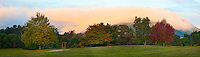 Panoramic Photo of Sunset in a Park at Lake Taupo, Waikato Region, North Island, New Zealand. This panoramic photo of sunset in a park in Lake Taupo was taken near the natural hot springs, a popular place for tourists to go and relax in the river.