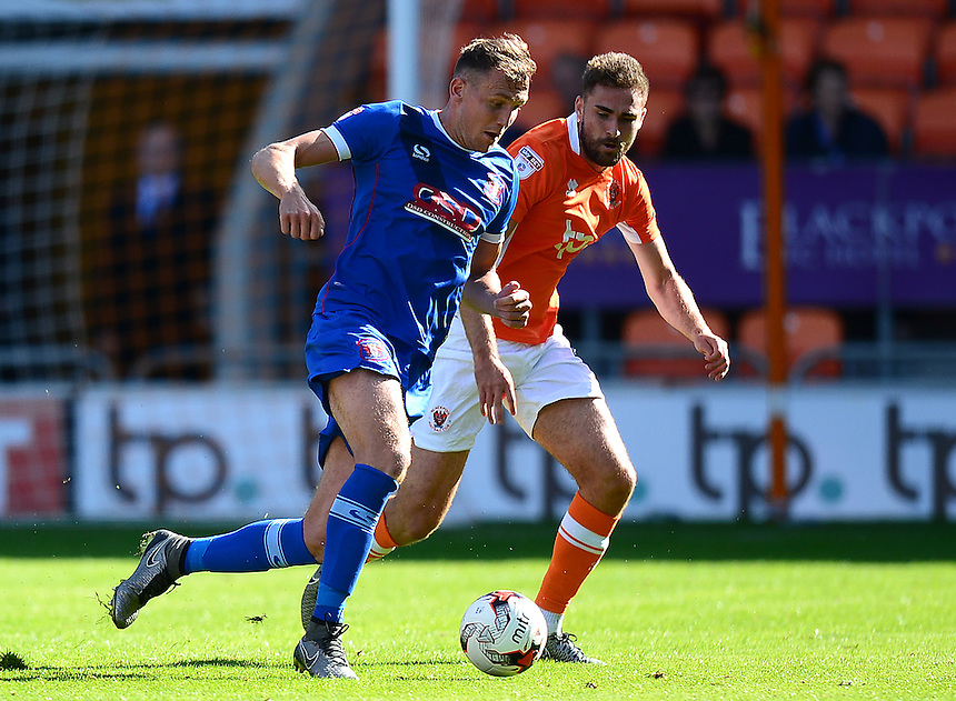 Blackpool's Clark Robertson competes with Carlisle United's Macaulay Gillesphey<br /> <br /> Photographer Richard Martin-Roberts/CameraSport<br /> <br /> The EFL Sky Bet League Two - Blackpool v Carlisle United - Saturday 17 September 2016 - Bloomfield Road - Blackpool<br /> <br /> World Copyright &copy; 2016 CameraSport. All rights reserved. 43 Linden Ave. Countesthorpe. Leicester. England. LE8 5PG - Tel: +44 (0) 116 277 4147 - admin@camerasport.com - www.camerasport.com
