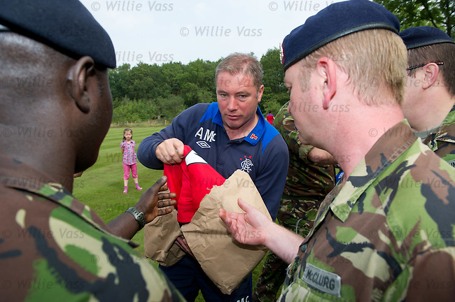 Ally McCoist hands out some Rangers tops to members of 1 Medical Regiment in Germany