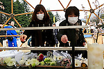 People leave candles during the fifth anniversary of the Great East Japan Earthquake and Tsunami disaster at the Peace on Earth memorial ceremony in Hibiya Park on March 11, 2016, Tokyo, Japan. Almost 19,000 people lost their lives as a result of the magnitude 9.0 earthquake and subsequent tsunami that hit Japan's north east coast 5 years ago. Five years after the event some 174,000 survivors are still in temporary accommodation. This includes nearly 100,000 from Fukushima who have not been able to return home as a result of the effects of the tsunami and nuclear catastrophe that ensued. (Photo by Rodrigo Reyes Marin/AFLO)