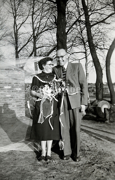 casual outdoors portrait of newly wed couple 1960s