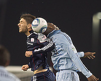 New England Revolution midfielder Stephen McCarthy (26) and Sporting Kansas City midfielder Birahim Diop (20) battle for head ball. In a Major League Soccer (MLS) match, the New England Revolution defeated Sporting Kansas City, 3-2, at Gillette Stadium on April 23, 2011.