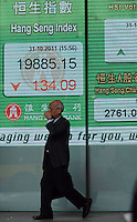 Local passes the Hang Seng Bank with the stock exchange prices for the day, 31-Oct-11.  Stocks prices have dropped all across the region in the past months as the economic outlook has worsened....................Locals pass the Hang Seng Bank with the stock exchange prices for the day, 31-Oct-11.  Stocks prices have dropped all across the region in the past months as the economic outlook has worsened..31-Oct-11...................