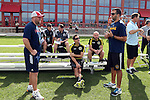 09 January 2015: Chicago Fire assistant coach Clint Mathis (left) talks with Los Angeles Galaxy assistant coach Kenny Arena (right) and Columbus Crew assistant Josh Wolff (seated). The 2015 MLS Player Combine was held on the cricket oval at Central Broward Regional Park in Lauderhill, Florida.