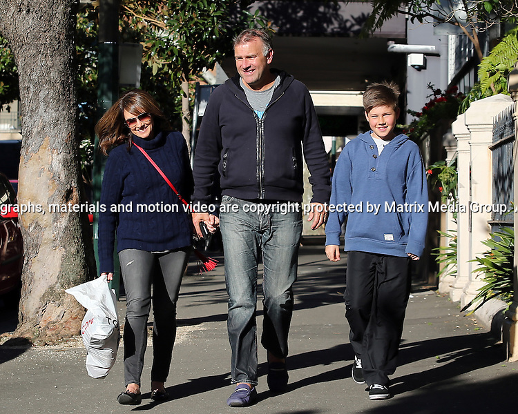 19 AUGUST 2013 SYDNEY AUSTRALIA<br /> <br /> EXCLUSIVE PICTURES<br /> <br /> Chris Bath pictured with her husband Jim Wilson and son Darcy walking home after lunch at Fei Jai Potts Point. After a few martini's over lunch Chris saw the funny side of  a surprise papping as she walked home. <br /> <br /> *No internet without clearance*.MUST CALL PRIOR TO USE +61 2 9211-1088. Matrix Media Group.Note: All editorial images subject to the following: For editorial use only. Additional clearance required for commercial, wireless, internet or promotional use.Images may not be altered or modified. Matrix Media Group makes no representations or warranties regarding names, trademarks or logos appearing in the images.