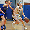 Kelly McLaughlin #32 of Northport, right, gets pressured by Samantha Groark #5 of Glenn during a Suffolk Shootout tournament game at Northport High School on Thursday, Dec. 28, 2017. McLaughlin contributed five points to Northport's 65-35 win.