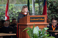 Guest speaker Sara El-Amine '07 addresses the graduates<br />
