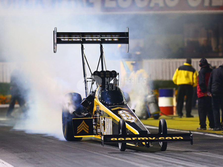 Feb 7, 2014; Pomona, CA, USA; NHRA top fuel dragster driver Tony Schumacher during qualifying for the Winternationals at Auto Club Raceway at Pomona. Mandatory Credit: Mark J. Rebilas-