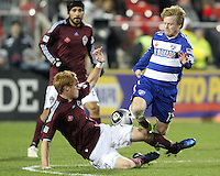 Dax McCarty#13 of FC Dallas clashes with Jeff Larentowicz#4 of the Colorado Rapids during MLS Cup 2010 at BMO Stadium in Toronto, Ontario on November 21 2010.Colorado won 2-1 in overtime.