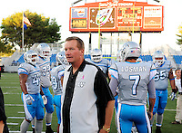 Oct. 8, 2009; Las Vegas, NV, USA; Las Vegas Locomotives head coach Jim Fassel with his players prior to the game against the California Redwoods in the inaugural United Football League game at Sam Boyd Stadium. Las Vegas defeated California 30-17. Mandatory Credit: Mark J. Rebilas-