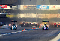 Nov 16, 2019; Pomona, CA, USA; NHRA top fuel driver Steve Torrence (left) races alongside Brittany Force during qualifying for the Auto Club Finals at Auto Club Raceway at Pomona. Mandatory Credit: Mark J. Rebilas-USA TODAY Sports