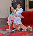 Lucy Liu Honored With Star On The Hollywood Walk Of Fame on May 01, 2019 in Hollywood, California.<br /> a_Lucy Liu 037 and son