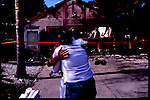 4-21-01. North Port resident Maria Delfa hugs a neighbor that is consoling her over the loss of her home to wildfires. Maria lived there with her husband Ray and son John.