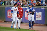 Buffalo Bisons starting pitcher Ryan Borucki (54), pitching coach Bob Stanley (46), and catcher Danny Jansen (41) walk to the dugout from the bullpen before a game against the Pawtucket Red Sox on August 31, 2017 at Coca-Cola Field in Buffalo, New York.  Buffalo defeated Pawtucket 4-2.  (Mike Janes/Four Seam Images)