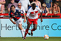 Lucas Akins of Stevenage escapes from Mike Edwards of Carlisle. Stevenage v Carlisle United - npower League 1 -  Lamex Stadium, Stevenage . - 18th August, 2012. © Kevin Coleman 2012