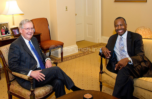 United States Senate Majority Leader Mitch McConnell (Republican of Kentucky), left, meets retired neurosurgeon Dr. Ben Carson, US President-elect Donald J. Trump's selection to be US Secretary of Housing and Urban Development (HUD), in his office in the US Capitol in Washington, DC on Wednesday, December 7, 2016.<br /> Credit: Ron Sachs / CNP /MediaPunch