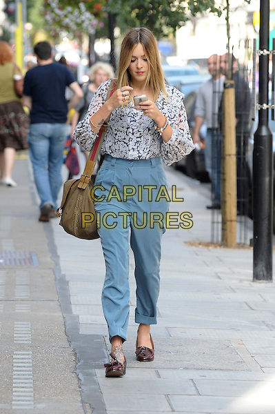 FEARNE COTTON.Spotted leaving work at BBC Radio 1, central London, England, UK, September 22nd 2010..full length canvas green khaki army bag shoulder red strap blue high waisted trousers loafers print shirt top blouse cell mobile phone white black grey gray tattoos .CAP/DYL.©Dylan/Capital Pictures.