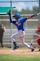 GCL Mets center fielder Stanley Consuegra (59) follows through on a swing during a game against the GCL Cardinals on August 6, 2018 at Roger Dean Chevrolet Stadium in Jupiter, Florida.  GCL Cardinals defeated GCL Mets 6-3.  (Mike Janes/Four Seam Images)