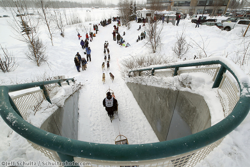 Saturday, March 3, 2012  Aaron Burmeister heads out of a tunnel near the Alaska Native Hospital along Ceremonial Start route of Iditarod 2012 in Anchorage, Alaska.