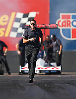 Feb 1, 2018; Chandler, AZ, USA; Gary Pritchett, crew member for NHRA top fuel driver Steve Torrence during Nitro Spring Training pre season testing at Wild Horse Pass Motorsports Park. Mandatory Credit: Mark J. Rebilas-USA TODAY Sports
