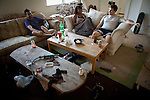 University of California, Merced students, from left, Sukrut Pagad, Ania Townsell, and Adam Hunter relax in the spacious rental home Pagad and Hunter share in Merced, Calif., October 29, 2011.