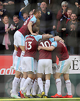 Burnley's Chris Wood (right) is mobbed by team-mates as he celebrates scoring the opening goal <br /> <br /> Photographer Rich Linley/CameraSport<br /> <br /> The Premier League - Burnley v Wolverhampton Wanderers - Saturday 30th March 2019 - Turf Moor - Burnley<br /> <br /> World Copyright © 2019 CameraSport. All rights reserved. 43 Linden Ave. Countesthorpe. Leicester. England. LE8 5PG - Tel: +44 (0) 116 277 4147 - admin@camerasport.com - www.camerasport.com
