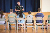 NWA Democrat-Gazette/J.T. WAMPLER Jef Bland, a corporal with the Siloam Springs police department, speaks Monday Aug, 3, 2015 to students during the Siloam Springs Police Department's Police Camp. The camp was held for teens interested careers in the law enforcement and legal system.