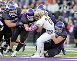 SIOUX FALLS, SD, OCTOBER 8:  Max Simmons #28 from Southwest Minnesota State University is brought down by a host of defenders from the University of Sioux Falls in the first half Saturday night at Bob Young Field. (Photo by Dave Eggen/Inertia)