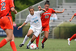 20 September 2009: North Carolina's Casey Nogueira (54) and Auburn's Christine Schweer (10). The University of North Carolina Tar Heels played the Auburn University Tigers to a 0-0 tie after overtime at Koskinen Stadium in Durham, North Carolina in an NCAA Division I Women's college soccer game.