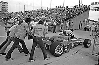 INDIANAPOLIS, IN - MAY 27: Crew members push AJ Foyt's Parnelli VPJ6C 005/Cosworth TC back toward Gasoline Alley during practice for the Indy 500 at the Indianapolis Motor Speedway in Indianapolis, Indiana, on May 27, 1979.