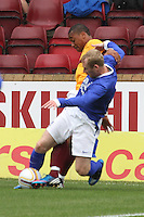 Tony Hibbert and Chris Humphrey tackle in the Motherwell v Everton friendly match at Fir Park, Motherwell on 21.7.12 for Steven Hammell's Testimonial.
