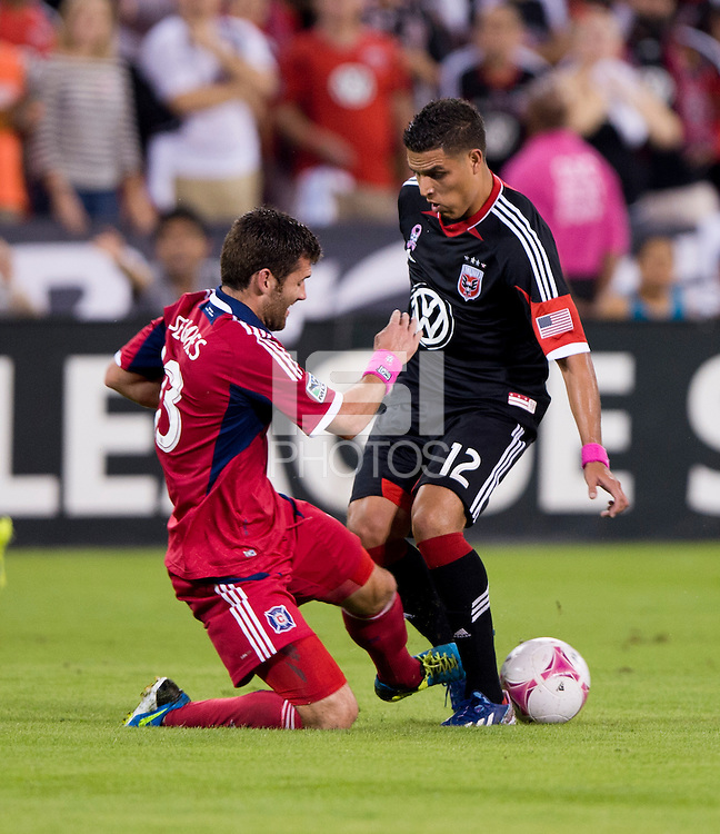 Gonzalo Segares (13) of the Chicago Fire collides with Luis Silva (12) of D.C. United during a Major League Soccer game at RFK Stadium in Washington, DC.  The Chicago Fire defeated D.C. United, 3-0.