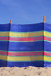 AJDN73 Colourful windbreak and deep blue summer sky