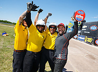 Apr 23, 2017; Baytown, TX, USA; NHRA top alcohol funny car driver Doug Gordon celebrates with members of the NHRA safety safari after winning the Springnationals at Royal Purple Raceway. Mandatory Credit: Mark J. Rebilas-USA TODAY Sports