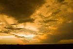 Golden and orange sunset after the breakup of a summer thunderstorm, rural Nebraska