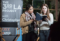 "Amber Thai '15, left, and Maddie Toll '15 read a poem from Dear Oxygen by Lewis McAdams of Friends of the Los Angeles River at a Third L.A. event titled ""What Do We Want the L.A. River to Be?"" April 22 at Clockshop Los Angeles.<br />