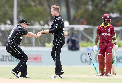 20th December, 2017, Whangarei, New Zealand;  New Zealand's Lockie Ferguson is congratulated on the wicket of Jason Mohammed. New Zealand Black Caps versus West Indies, first One Day International cricket, Cobham Oval, Whangarei, New Zealand. Wednesday, 20 December, 2017.