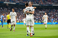 Gareth Bale and Marco Asensio of Real Madrid celebrating after scoring a goal during the match between Real Madrid v Getafe CF of LaLiga, 2018-2019 season, date 1. Santiago Bernabeu Stadium. Madrid, Spain - 19 August 2018. Mandatory credit: Ana Marcos / PRESSINPHOTO